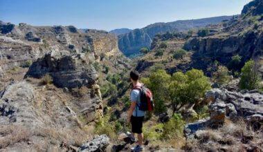Nomadic Matt standing near the edge of a cliff in Africa