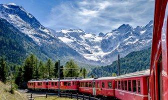 A train speeding through the mountains of Switzerland