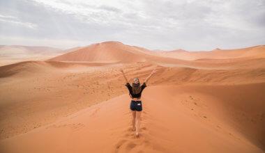 Kristin Addis walking on a sand dune