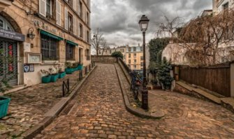 A winding, narrow cobblestone street in Paris