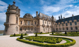 The historic Chantilly chateau in France surrounded by its beautiful gardens