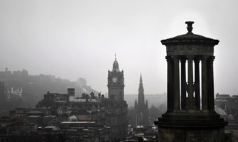 A black and white photo of the city of Edinburgh