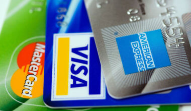 an assortment of business credit cards, including a Visa, Mastercard, and American Express