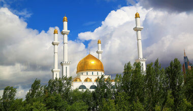a mosque in Kazakhstan with golden domes