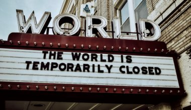 A movie theater billboard saying the world is closed