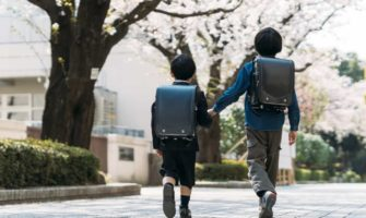 Two young Japanese students walking to school