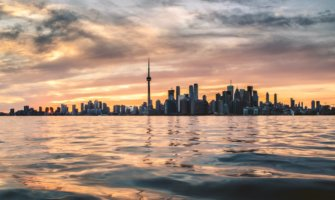 n orange sunset over the Toronto skyline in summer