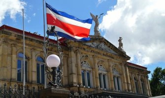 The Costa Rican flag waving in front of the historic theater in San José, Costa Rica