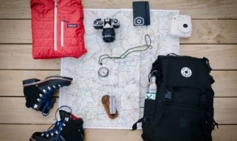 A map, backpack, and other gear for travel