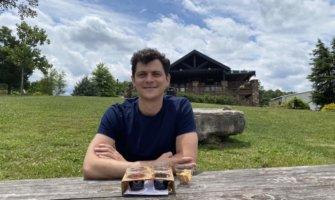 Nomadic Matt sampling beers at a picnic table
