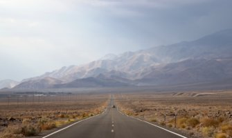 A car driving an open road in Death Valley, USA