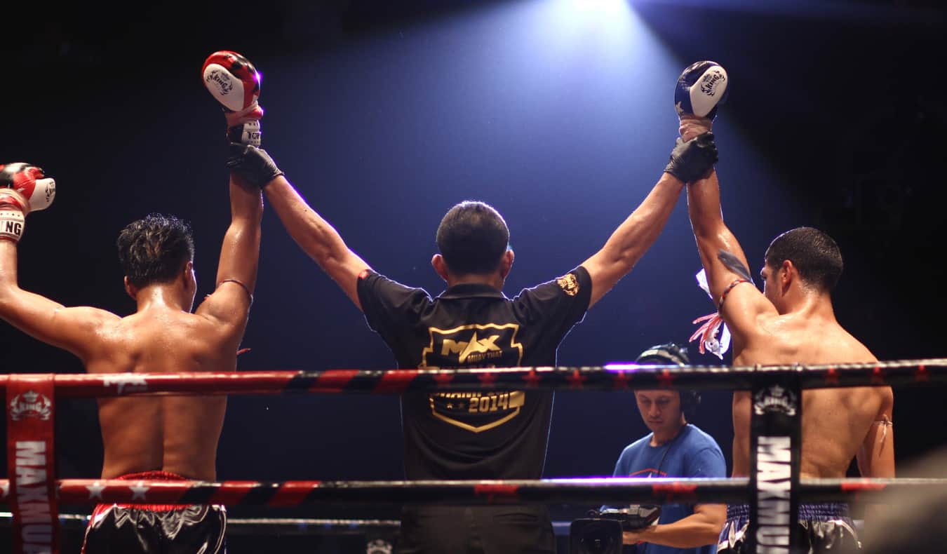 Two Thai boxers in a ring in Thailand