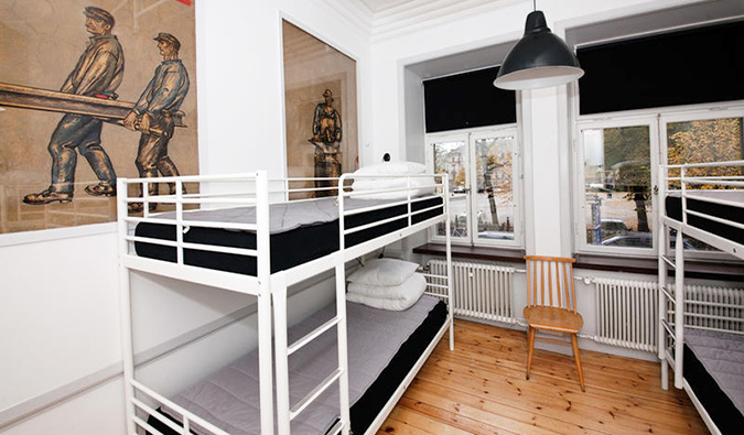 An empty hostel dorm with bunk beds