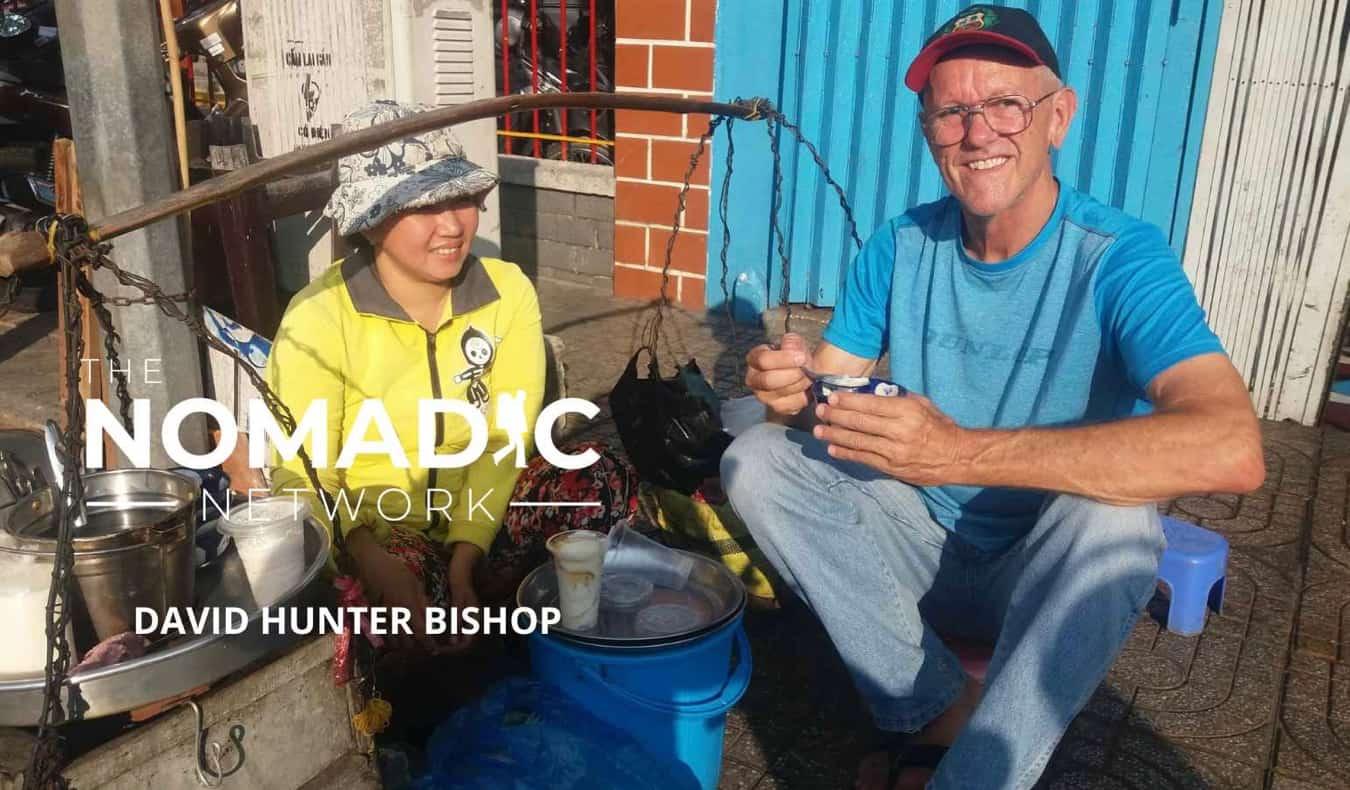 Senior traveler David Bishop posing for a photo abroad