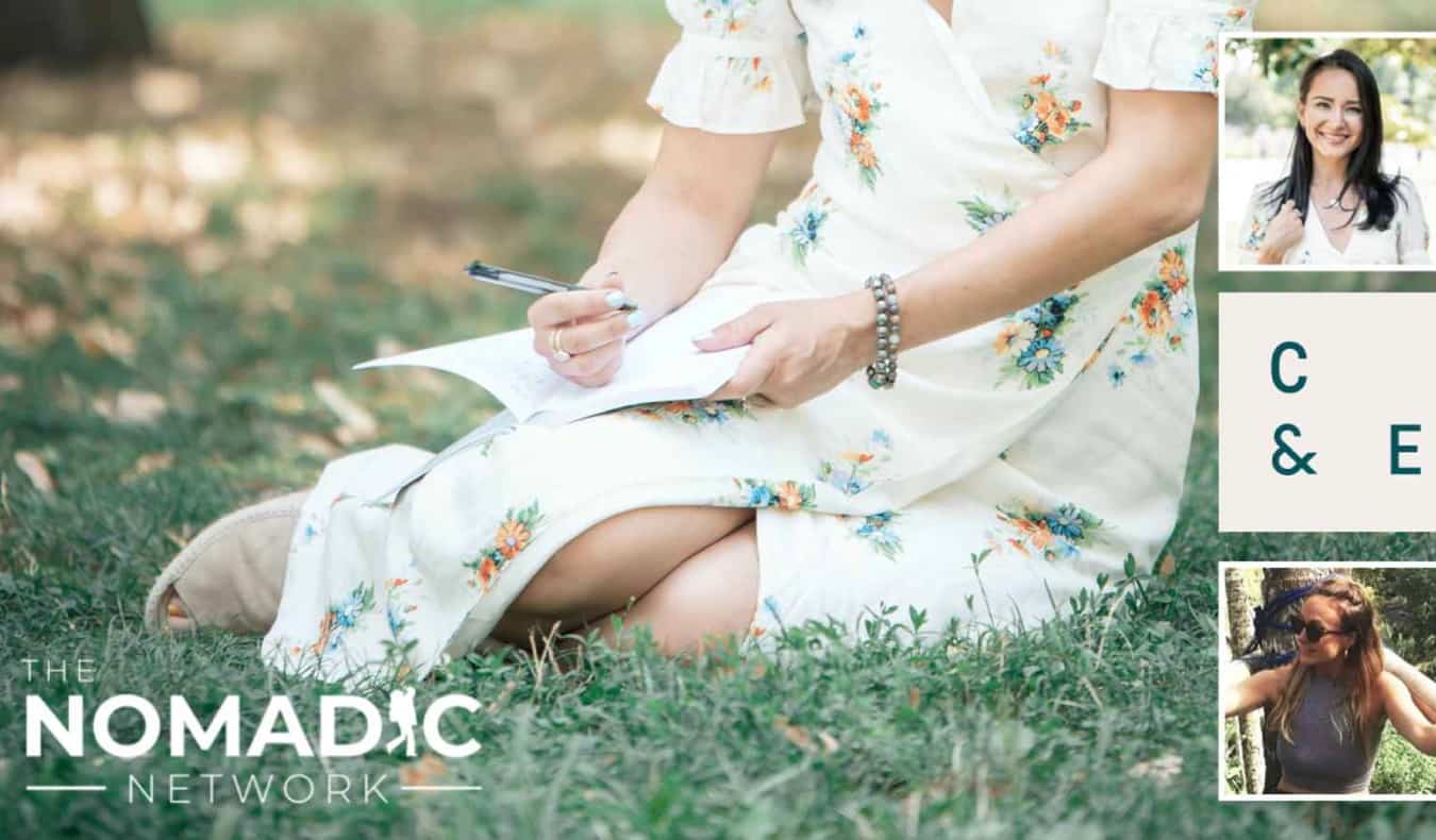 A woman journaling in the grass