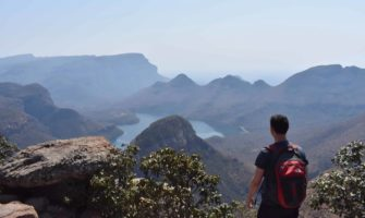 Nomadic Matt in Africa near the mountains