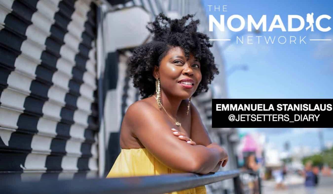 A black solo female traveler posing on a balcony abroad
