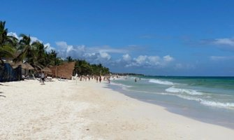 A wide beach on a sunny day in Tulum, Mexico