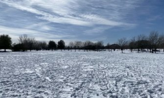 A snowy field in Austin, Texas after a snow storm in 2021