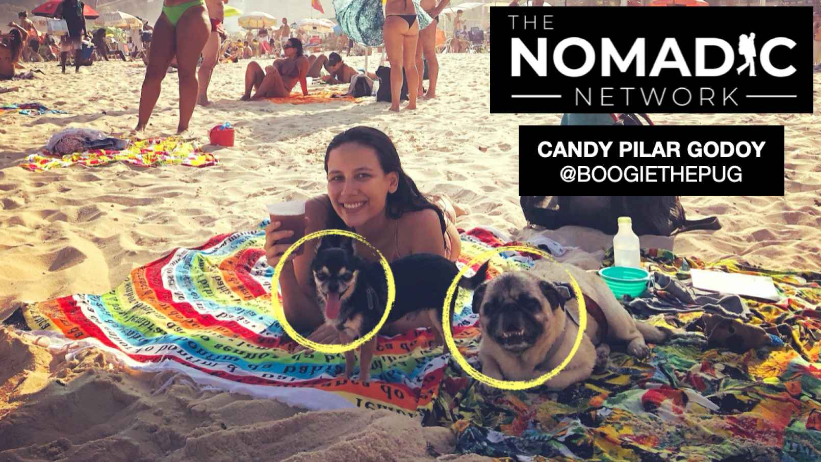 CAndy posing with her dogs at the beach