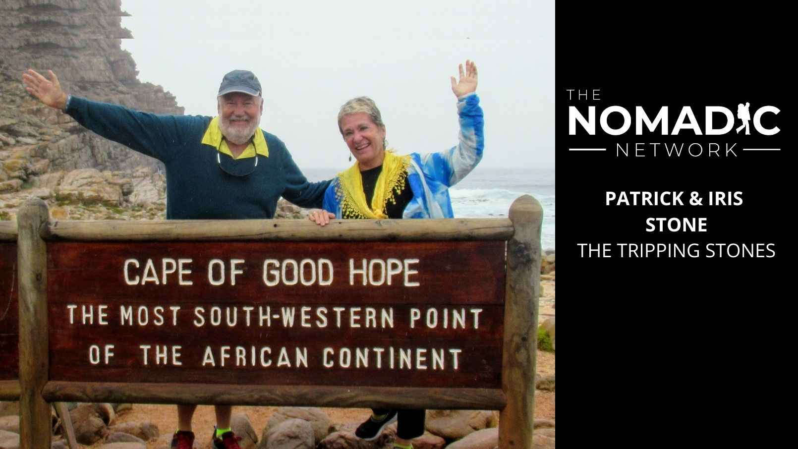 A retired couple posing at the Cape of Good Hope