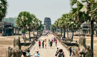 A crowd of tourists entering Angkor Wat in Cambodia