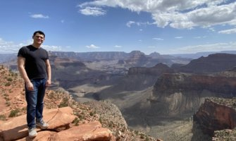 Nomadic Matt standing at the edge of the Grand Canyon
