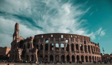 The ancient Roman Coliseum set against a blue sky in summer in Rome, Italy