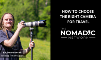 travel photographer Laurence Norah with his long camera lens extended