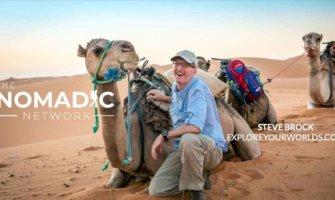 Author and traveler Steve Brock in the Sahara Desert with a camel