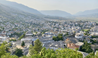 The view overlooking a small town in Albania surrounded by lush mountain