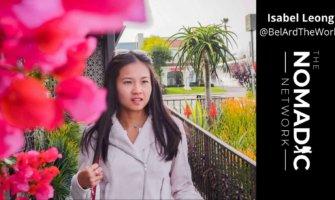 travel blogger Isabel Leong walks through garden with pink flowers