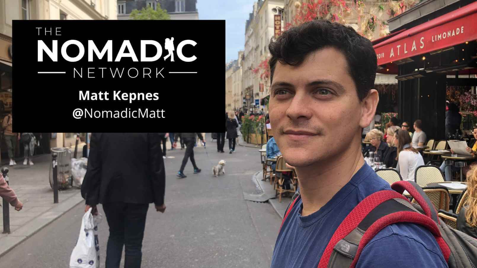 Nomadic Matt Kepnes with read backpack in streets of France