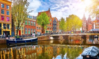 The colorful canal houses along the water in Amsterdam, Netherlands