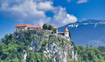 The towering Lake Bled castle in Slovenia perched on a tall cliff