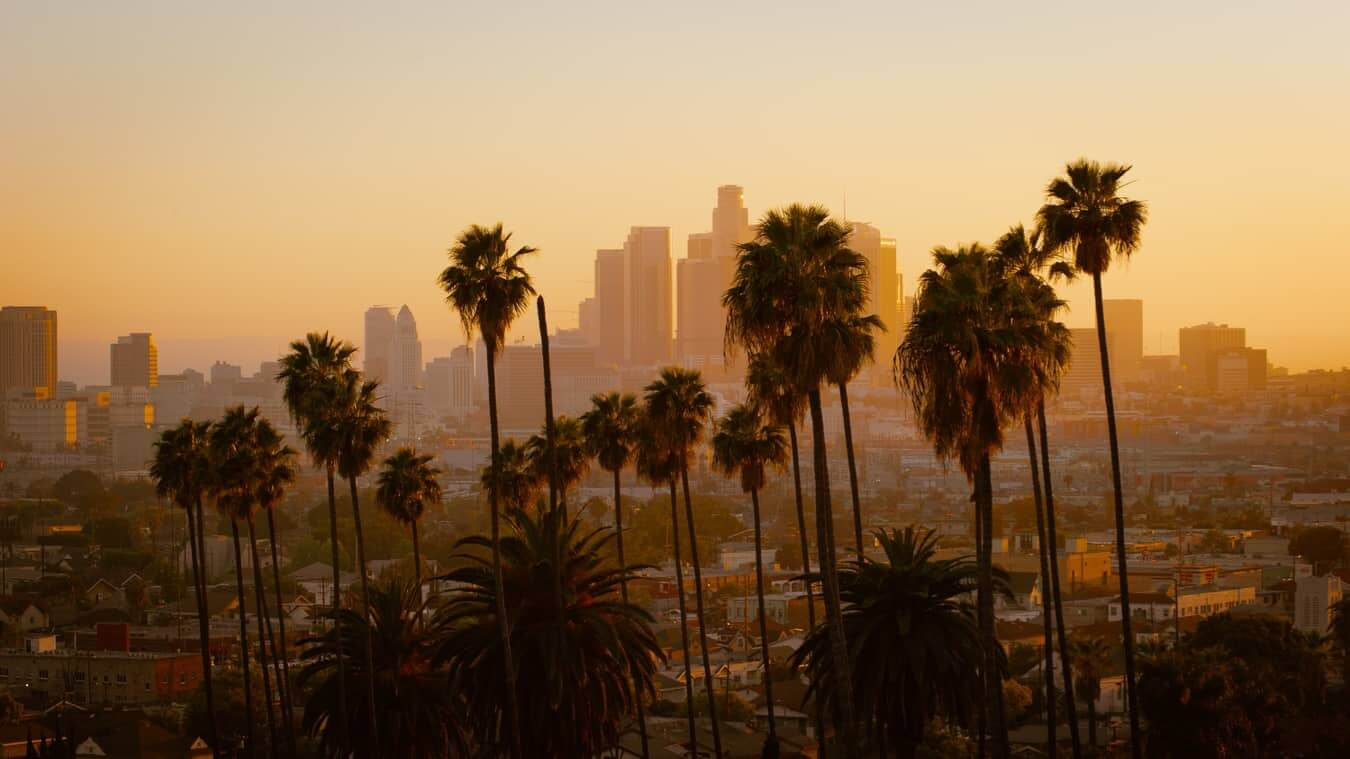 A bright sunset over LA with the skyline in the distance